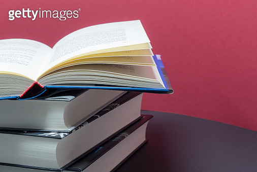 Close-Up Of Stacked Books On Table - gettyimageskorea
