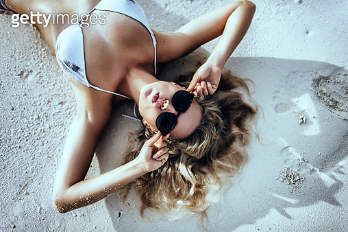 Attractive young caucasian woman in Maldives enjoying vacation, lifestyle, beautiful young adult woman, tropical island, resort, turquoise water, swimwear, luxury vacation - gettyimageskorea