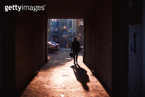 Rear View Of Silhouette Man Walking At Doorway During Sunset - gettyimageskorea