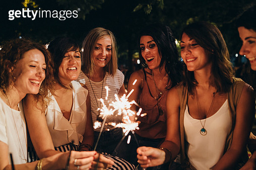 Friends having fun together with sparklers - gettyimageskorea