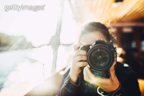 Young woman using a DSLR camera - gettyimageskorea