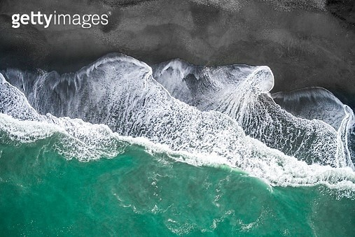 Waves on the beach, turquoise sea and black sand beach, aerial view, west coast, south island, New Zealand - gettyimageskorea