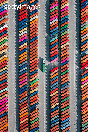 Aerial shot of a truck picking up a cargo crate in a container yard, Georgia, United States of America - gettyimageskorea