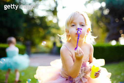 young girl in tutus blowing bubbles - gettyimageskorea