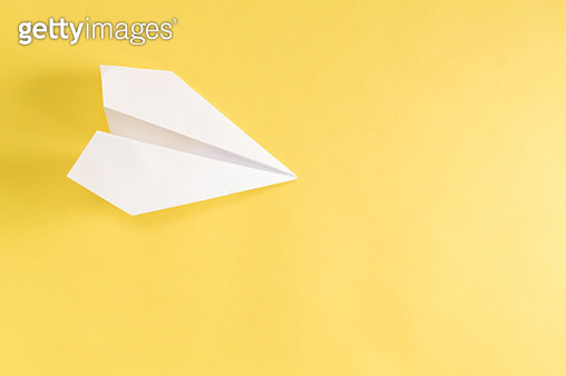 Paper airplane on yellow - gettyimageskorea