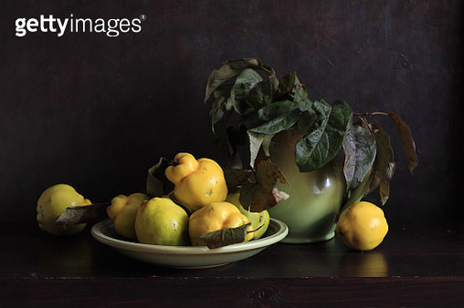 Quinces And Green Apple Leaves - gettyimageskorea