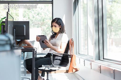 Women wear masks to work in office - gettyimageskorea
