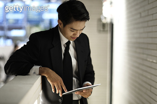 Businessman using digital tablet - gettyimageskorea