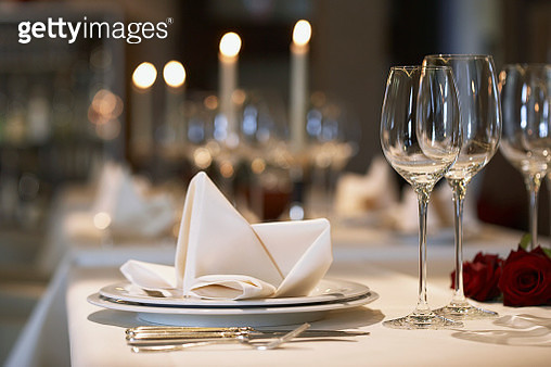 Napkin on plate at elegant place setting - gettyimageskorea