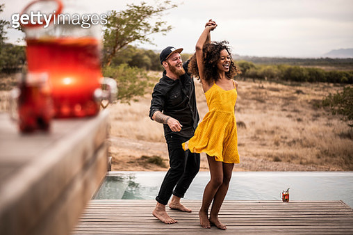 Happy couple dancing on deck of a lodge, Cape Town, South Africa - gettyimageskorea
