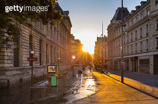 Road by buildings against clear sky during sunset, Paris, France - gettyimageskorea