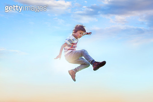 a boy jumping in air for joy - gettyimageskorea