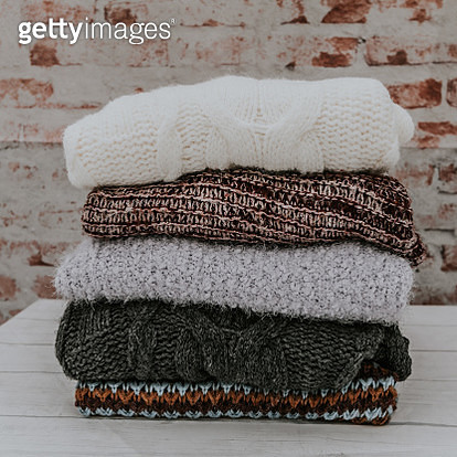Variety of sweaters piled up. - gettyimageskorea