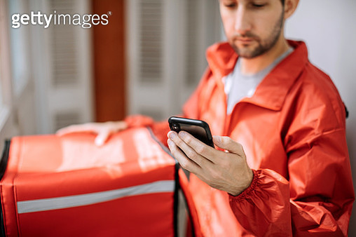 Food delivery man getting ready for work - gettyimageskorea