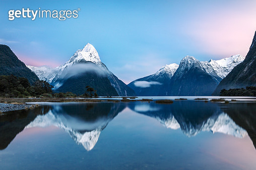 Awesome sunrise over Mitre peak and mountains of Milford Sound, Fiordland National Park, Southland, New Zealand - gettyimageskorea
