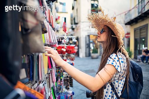 Teenage girl buying smartphone case at street shop. Nikon D850 - gettyimageskorea