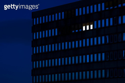 Germany, Dusseldorf, Lighted windows in office building - gettyimageskorea