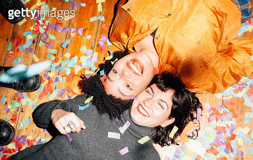 Group of young people at a party with confetti - gettyimageskorea