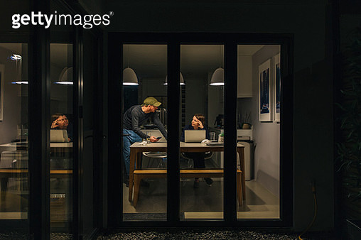 Woman working from home late. Partner offers support - gettyimageskorea