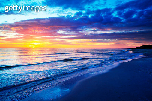 Empty Beach and Ocean during Sunset - gettyimageskorea