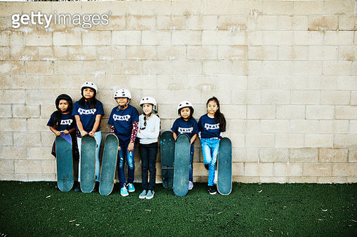 Portrait of young female friends at skateboarding camp - gettyimageskorea