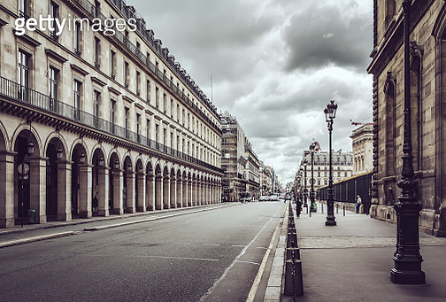 Empty Rue De Rivoli street against dramatic sky in Paris - gettyimageskorea