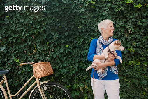 Woman with dog - gettyimageskorea