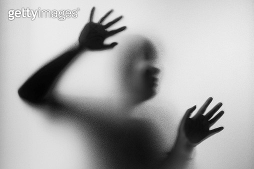 Person Seen Through Frosted Glass - gettyimageskorea