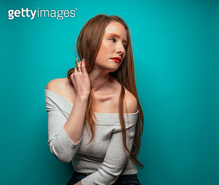 Beautiful woman on blue background - gettyimageskorea