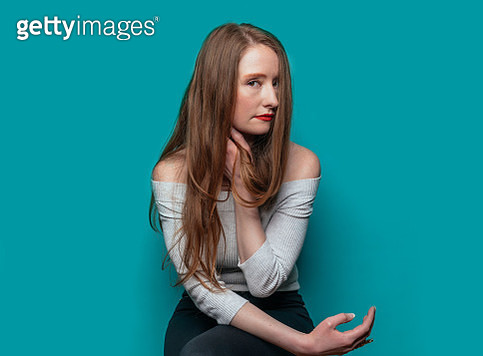 Beautiful woman on blue background - gettyimageskorea
