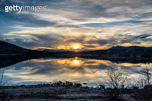 Scenic View Of Lake Against Sky During Sunset - gettyimageskorea