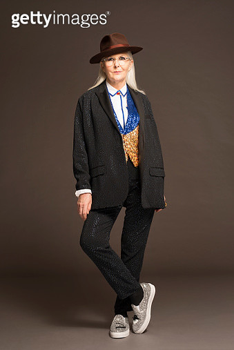 Mature woman wearing hat and stylish clothes - gettyimageskorea