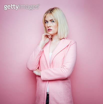 Blond woman wearing pink winter jacket - gettyimageskorea