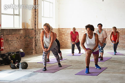 Female fitness trainer leading a class at the gym - gettyimageskorea