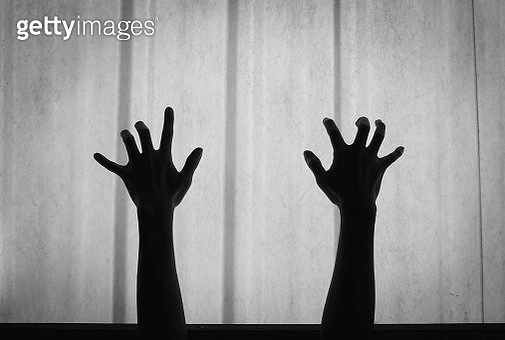 Silhouette Of Hands Gesturing Against Wall At Home - gettyimageskorea