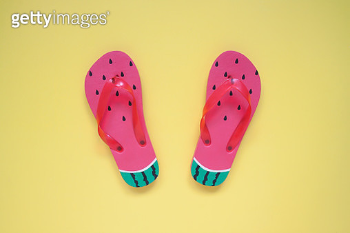 Directly Above Shot Of Flip Flops On Yellow Background - gettyimageskorea