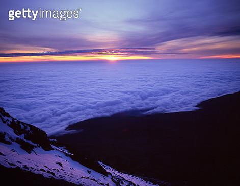 Sunrise over distant Kenya from Mount Kilimanjaro - gettyimageskorea