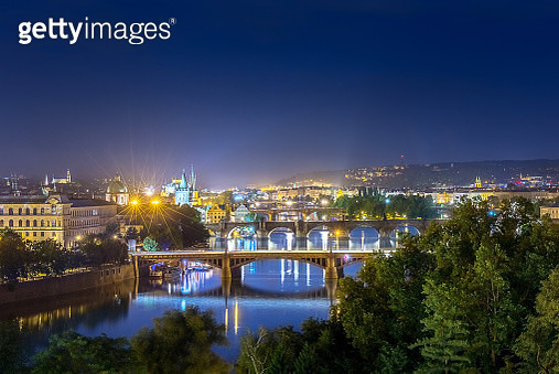Aerial view of St. Charles bridge and old town tower with crowd of people travel on the bridge at night after sunset time at Prague, Czech Republic, Europe - gettyimageskorea
