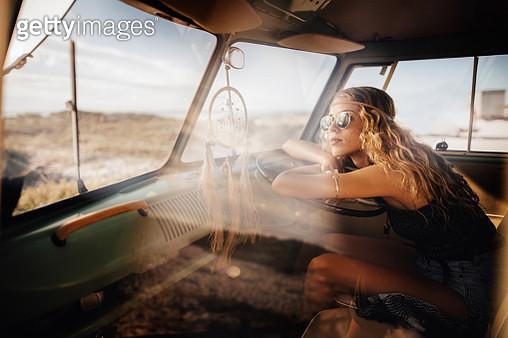 Road Trip Hipster Girl Sitting in Retro Van at beach - gettyimageskorea