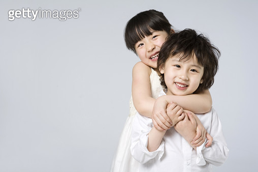 Brother and sister embracing - gettyimageskorea