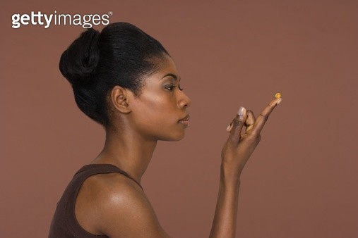 Young woman holding a capsule - gettyimageskorea