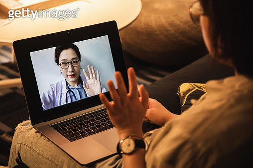 consulting asian doctors online using laptop - gettyimageskorea