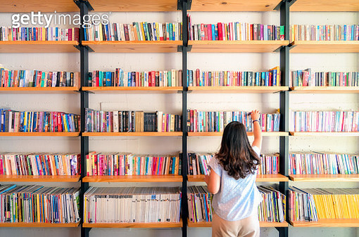 Asian women are picking up books on the bookshelf. To prepare to back to school - gettyimageskorea
