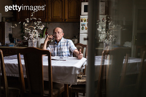 Man talking on phone from his living room - gettyimageskorea