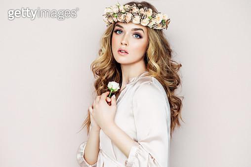 Studio shot of young beautiful woman - gettyimageskorea