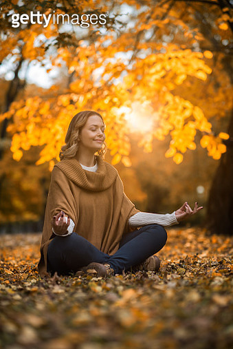 Mid adult woman enjoying in Yoga relaxation exercises in nature. - gettyimageskorea
