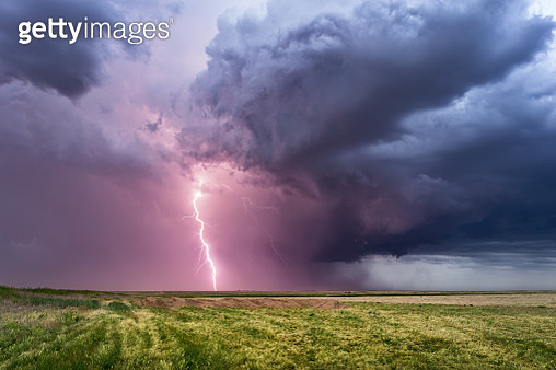 Scenic View Of Lightning Over Field - gettyimageskorea