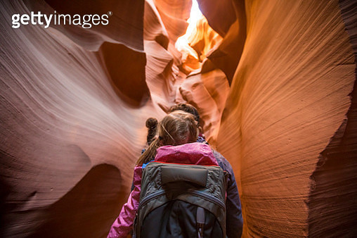 Rear view of father carrying daughter while walking amidst rock formations at Page - gettyimageskorea