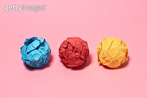 Crumpled Paper Balls on Pink Background - gettyimageskorea