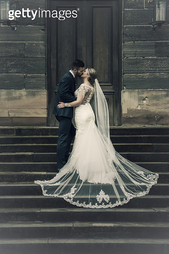 Bride And Bridegroom Kissing On Steps - gettyimageskorea
